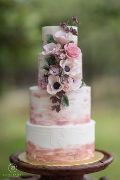 Watercolor wedding cake idea - four-tier wedding cake with pink watercolor details and flowers {Batter Up Cakery}