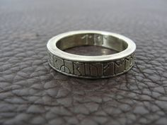 This is a reproduction of the Kingmoor ring, one of seven known runic rings from the Anglo-saxon period. The original is is currently in the British Museum. They have based this off of numerous photos and and published measurements. Like the original it's a big ring - size 13 US (Z+1 UK), but is made from manganese bronze instead of gold. The runes are the same the originals, including the last 3 on the interior of the ring. They have copied the style of the runes as closely as they can. The…