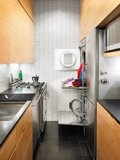 pozner residence laundry. soon we will live in a house where the only place for laundry is the kitchen. it can work!