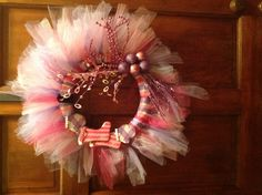 Adapted awesome Xmas wreath for pink and purple party.