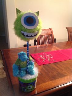 Monster university center piece made this for my nephews first B-day.      Glo tutus