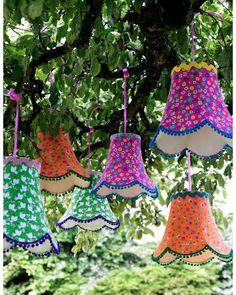 How cool would this be for a backyard party at night! Tree Lanterns!