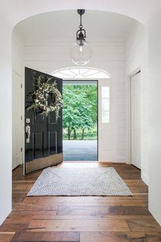 Modern Farmhouse Entryway Black Door Flanked by Side Lites #entryway #entrywayideas #entrywaydecorideas #entrytable #farmhousedecor #modernfarmhouse #modernfarmhousedecor