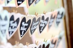 hanging chalkboard hearts wedding seating idea