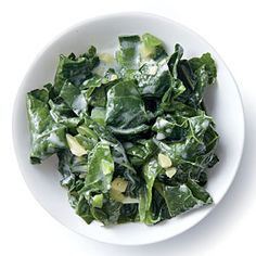 Wilted Kale with Coconut, Ginger, and Lime | MyRecipes.com.  All my kids not only ate this but loved it!  Even my picky one :)