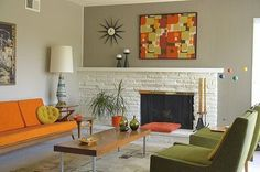 Great retro mid-century living room. Painted paneling, two wall colors, star burst clock. So much happy!