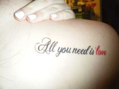 "A tattoo with lyrics from the Beatles' song ""All You Need Is Love""."