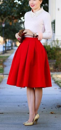 Pretty and preppy Spring look with a full red skirt and collared sweater.