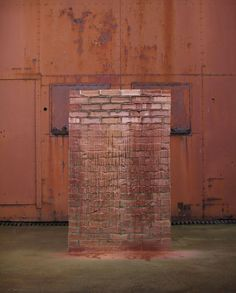 A Pound of Flesh for 50p.  Hackney artist Alex Chinneck has created a wall that melts in the sun as part of his research for a project to build a melting house.