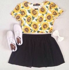A sunflower crop top paired with black shorts. Some plain white keds and a adorable lace bow! Don't forget to add a cozy tan cardigan!