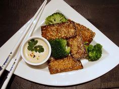 Sesame-roasted tofu with satay sauce and broccoli