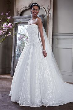 Davids Bridal, Fall 2013.   I feel like this is my dress instead of the one I have.