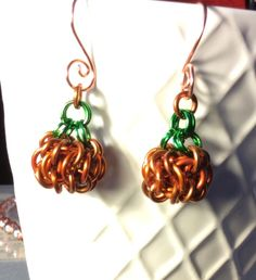 Cute little Chainmaille pumpkin earrings made from 2 different size orange and and green rings for the stem. These are round about high , wide. Drop length about Ear hooks are copper non tarnish wire. Fall Jewelry, Jewelry Necklaces, Jewellery, Green Rings, Orange Rings, Earrings Handmade, Handmade Jewelry, Halloween Jewelry, Coin Pendant