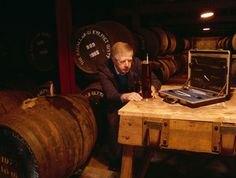 Checking alcohol level after maturation in oak casks at the Macallan Distillery.