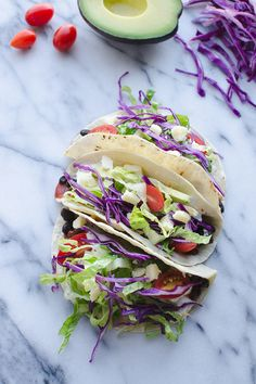 Get dinner on the table in a flash with these Ten Minute Black Bean Tacos! Super simple with pantry ingredients and some fresh toppings! Vegetarian | Vegan Friendly | @tasteLUVnourish
