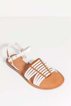 A totally fab pair of huarache-inspired sandals, featuring a strappy braided leatherette body, open toe, and adjustable ankle strap. Cushioned insole. Low flat heel. $18.50