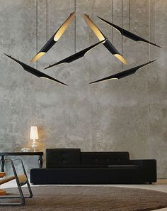 Coltrane is ideal for hotel lobbies and lighting installation projects. It's a fine decorative element, with a contemporary and sculptural feel. This modern lamp is adjustable height with magnetic cable. 100% handmade and customizable.