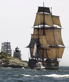 """A replica of the HMS Bounty, right, sails past a lighthouse as it departs Narragansett Bay and heads out to sea off the coast of Newport, R. The Ocean State Tall Ships Festival came to a close in Newport with a """"Parade of Sail. Tall Ships, Bateau Yacht, Hms Bounty, Narragansett Bay, Old Sailing Ships, Abandoned Ships, Out To Sea, Sail Away, Set Sail"""
