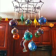 love the way they display their witch balls...gotta do this