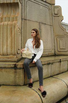 white shirt + straw bag