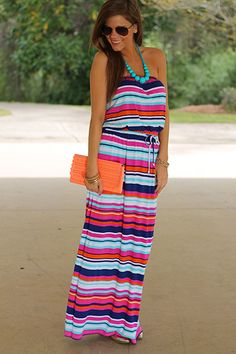 This striped summer maxi has it all for sure! Bright colors, fabulous pocket, comfy material and a drawstring waist! We couldn't ask for much more! :) Fits true to size. Miranda is wearing the small.
