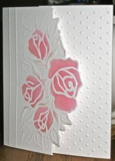 handmade greeting card ... embossed roses sponged in pink ... luv how the edge is cut along the outline of the rose cluster... mostly white .... delightful card ...