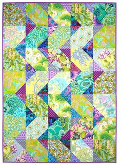 Cascade is a great modern quilt pattern loaded with extras! This pattern includes two basic versions. Choose either a scrappy eclectic look or a controlled geometric zigzag look. A versatile pattern that's sized to work with layer cakes, large scraps, fat quarters or yardage. It