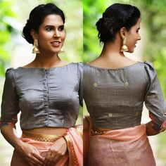 Boatneck blouses have a way of charming every Indian woman. Flirty yet feminine, this grey semi silk blouse, with it's subtle puffed… Saree Jacket Designs, Saree Blouse Neck Designs, Stylish Blouse Design, Fancy Blouse Designs, Boat Neck Saree Blouse, Indian Blouse Designs, Sari Dress, Kurta Designs, Traditional Blouse Designs
