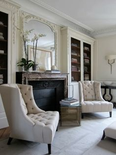 love the way the books are stacked horizontally in the bookcases. I think I'm going to have to try that