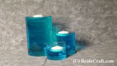 Add food coloring to water! Teal water.. With lace around the jars? Good idea for some of the jars :)