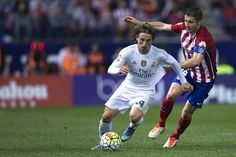 Luka Modric of Atletico de Madrid competes for the ball with Gabi Fernandez of Atletico de Madrid during the La Liga match between Club Atletico de Madrid and Real Madrid CF at Vicente Calderon Stadium on October 4, 2015 in Madrid, Spain. (Oct. 3, 2015 - Source: Gonzalo Arroyo Moreno/Getty Images Europe)