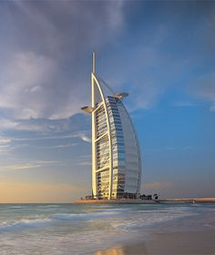 Burj Al Arab, Dubai, UAE  This 60-story sail-shaped hotel, which sits on its own private island, was designed to be a national icon. But the interior is where the beauty lies: a nearly 600-foot-tall atrium—the world's tallest. The undersides of tier after tier of semicircular balconies reveal a spectrum of colors. And the tower's powerful diagonal braces, like the flying buttresses of the past, inspire awe.