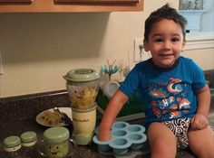 Big Brother Helping Mommy Make Applesauce for Little Sister