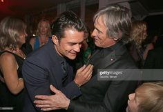 Actors Orlando Bloom and Viggo Mortensen attend Sierra Affinity's Captain Fantastic Cocktail Party at Nikki Beach Carlton Beach Club on May 17, 2016 in Cannes, France.