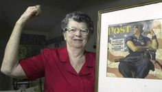"Mary Doyle Keefe poses at her home in Nashua, N.H., with the May 29, 1943, cover of the Saturday Evening Post for which she had modeled for artist Norman Rockwell who painted her as ""Rosie the Riveter."" Keefe died Tuesday, April 21, 2015, in Simsbury, Conn. She was 92."