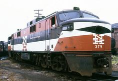 New Haven Railroad GE EP-5 locomotive # 379, is out of service while awaiting disposition in an unknown yard area, 1960's, Mac Seabree Collection by alcomike43, via Flickr