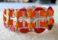 Original, Handmade with Tabs, Ribbon and Glitter Glue. Bracelet is connected by Jump Rings and a Spring Ring Clasp  Size - 6 1/2""