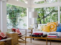 love these colorful throw pillows - great accents in an otherwise clean/minimalist space