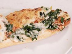Swiss Chard au Gratin French Bread Pizzas - must taste good, but it is ridiculous with calories, of course her portion size is ridiculous too.