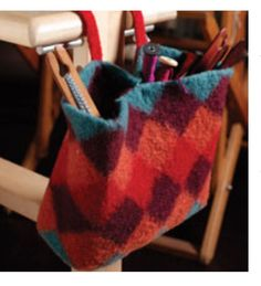 Make Handmade Bags that are Practical and Stylish. Free down load from Weaving Today  A Felted Bench Bag for Weaving Tools by Deborah Shelmidine   When you have to sit and wait—in the doctor's office, at your children's sporting events, or on road trips—you can have fun weaving colorful fabrics on portable, easy-to-use pin looms. This project arranges woven squares in four different colors along the diagonal to make a handy bag to hang from the upright of a loom bench. Add a second handle…
