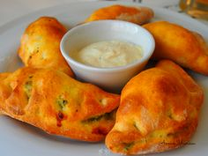 Pierogi = Traditional Polish pie with cream cheese spinach filling.