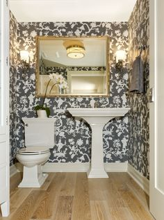 Powder Room designed by Enviable Designs - A dramatic wallpapered powder room.