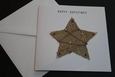 Gorgeous jute star Christmas card by Dotty Rainbow  Card specifics  * 15cm x 15cm * white hammer effect finish 300gsm quality card * white envelope * hand cut jute star * tiny baubles * Inside left blank for your own message   The card comes in a protective cellophane envelope. All