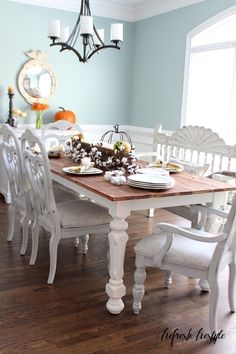 Love the aqua wall color in this light and bright Fall home tour. (and that farm table!)