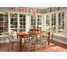 bright and open space full of windows and love the picture ledge above dining room