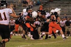 2015 Leesburg Yellow Jackets Football Archives, Umatilla at Leesburg spring game, Leesburg Martavius picks up tough extra yardage as several Umatilla defenders come in to make the tackle during Leesburg's 24-16 victory in the spring game. (Chris Hays, Orlando Sentinel), Carver Heights Quarterback Club, Leesburg High School, Leesburg, Florida