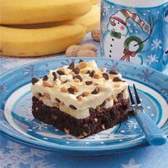 Banana Cream Brownie Dessert.  Fudge brownie mix, chocolate chips, peanuts, bananas, vanilla pudding and whipped cream.