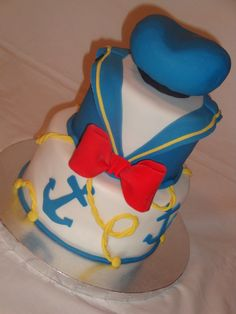 This is the birthday cake I made for my youngest son's 1st birthday. PB and J cake covered with fondant, hat sculpted out of cake. TFL!