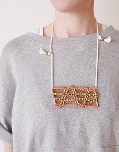 Erin Considine necklace. Brass, mesh, cotton dyed with madder.
