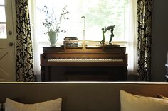 Living room with piano.